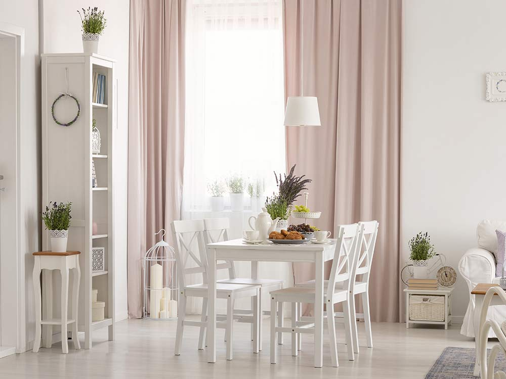 Living room with day curtains letting soft light in. Pink dimout curtains gives the room a modern look.