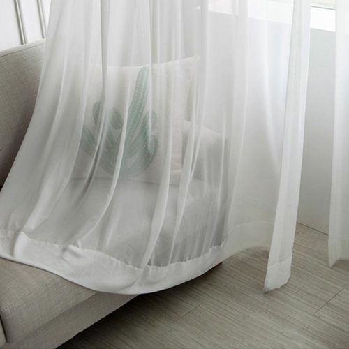 Floor drop white day curtain on a modern sofa, giving the room a soft look.
