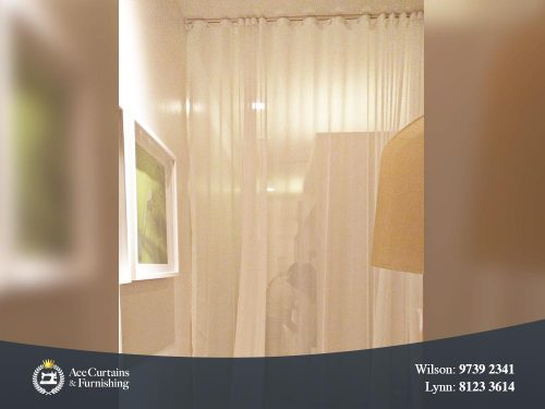 S Fold Curtain or Ripple fold curtain used as room separator or partition.