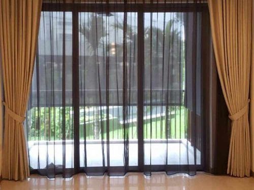 Black day curtains with gold night dim out curtains for long balcony window.