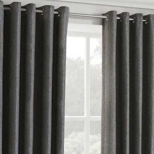 Gray eyelet dimout curtain with metal curtain rod.