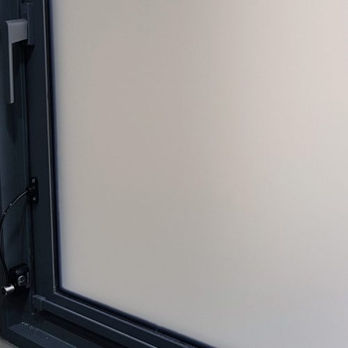 Remsafe cable lock with opaque frosted window film protects privacy.
