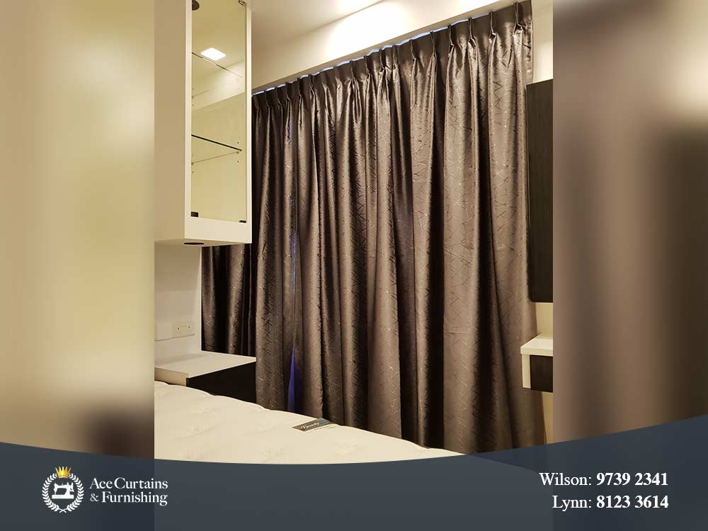 Brown satin dimout curtains acting as a room partition and separator.