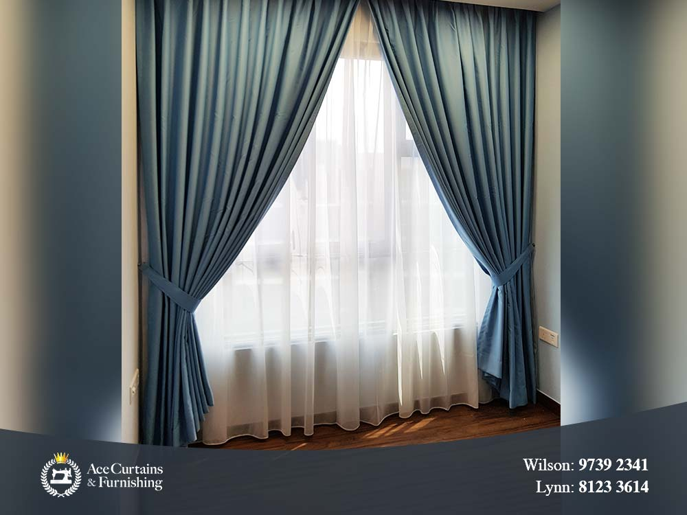 Posh majestic blue night curtain with soft day curtain for a bedroom.