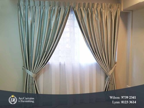 Silver satin shiny night curtains and soft day curtains installed in a bedroom.