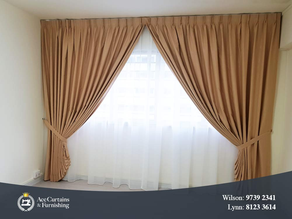 Beige bedroom day and night curtains that are held back with a tie-belt.
