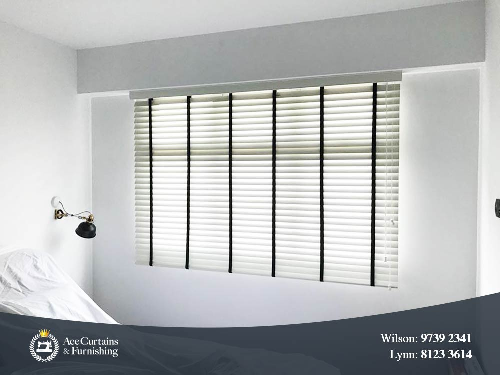 Black and white venetian blind that filters light.