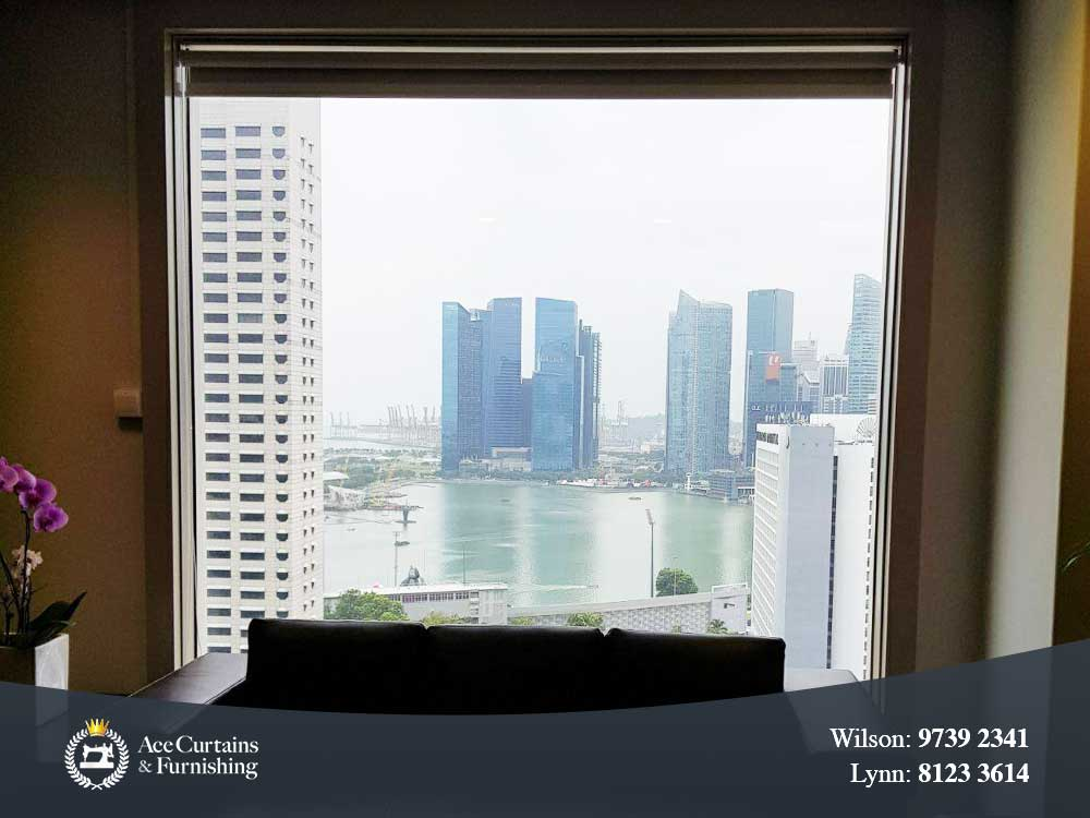 Commercial office roller blind pulled up overseeing Singapore architecture.