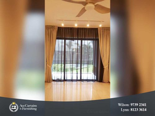 Long floor drop black day curtain and dimout curtain in a living room.