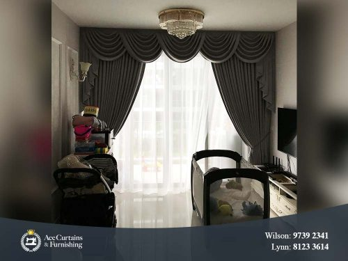 Day and night curtain with swag gives the living room a luxurious look.