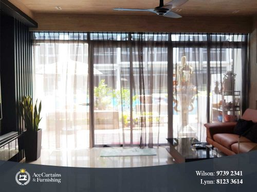 First floor condo with black day curtains installed for home privacy.