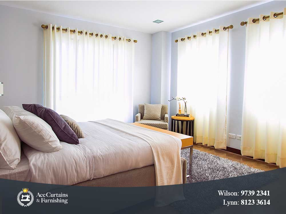 Sheer eyelet curtains giving a luxury style in the bedroom.