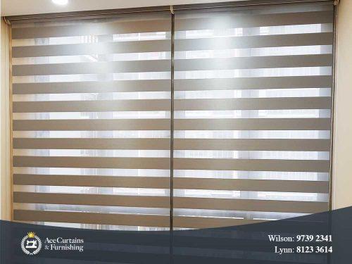 Grey Zebra blinds for bedroom adjusted to filter day light.
