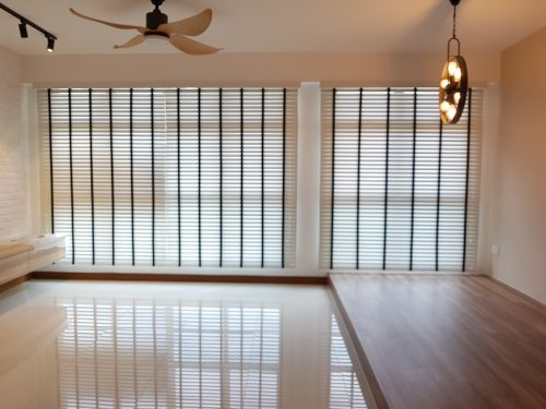 Living room venetian blinds with minimalist interior design.