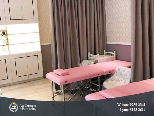 Beauty salon with curtain partition for clients' privacy.