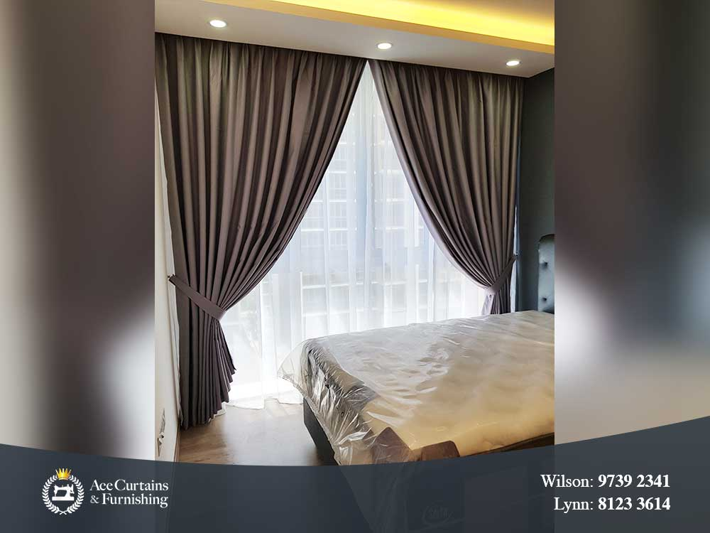 Luxury grey day and night curtains set for a condo's bedroom.