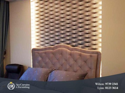 Premium wallpaper with a 3D effect behind a bed in a bedroom.