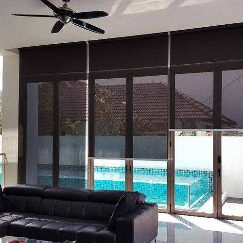 Black roller blind sunshade in a private home with swimming pool