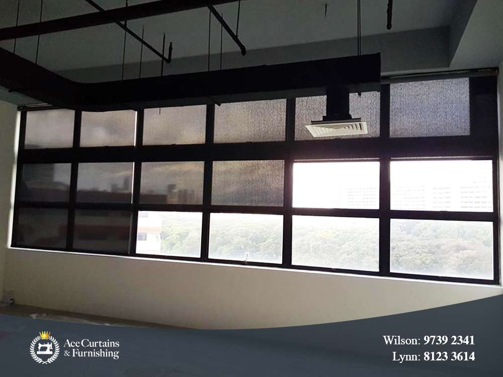 Black roller blinds for commercial shade acting as window shade.