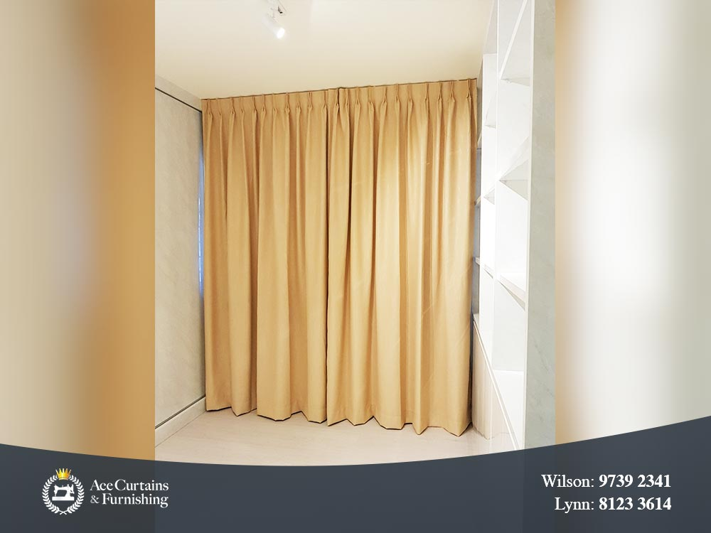 Yellow pleated dimout curtain acting as room partition.