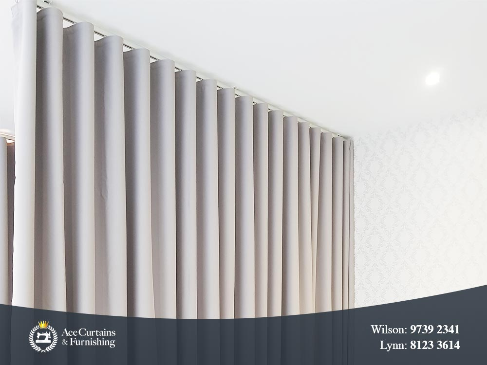 S Fold or Ripple fold curtain used as a day curtain or room separator.