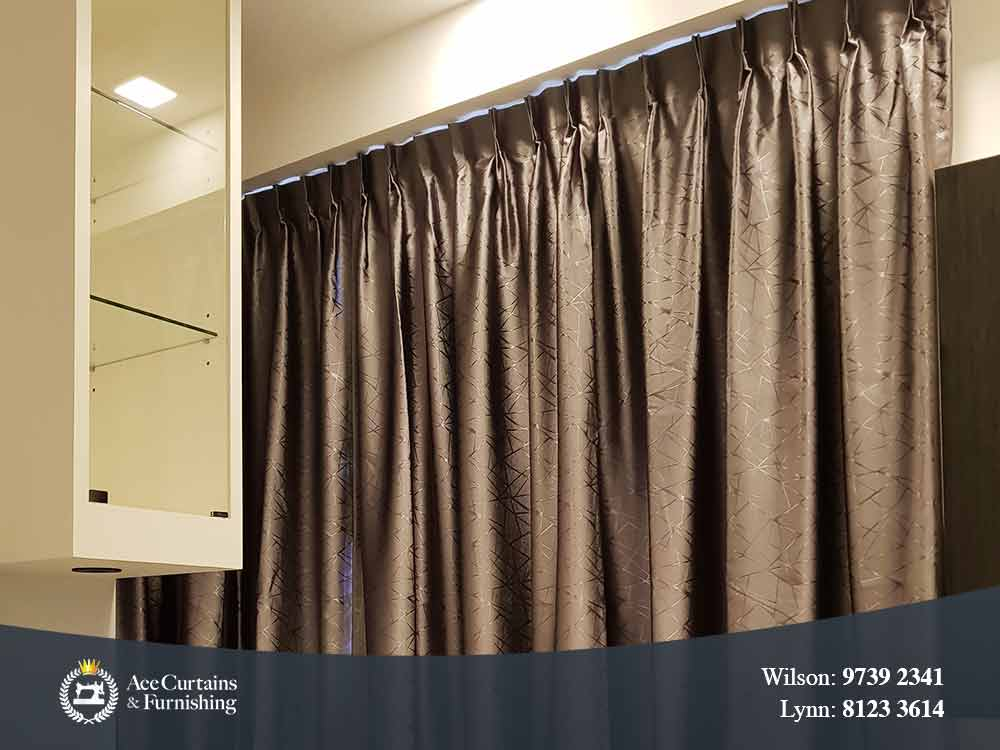 Closeup of satin pattern and pleated curtain.