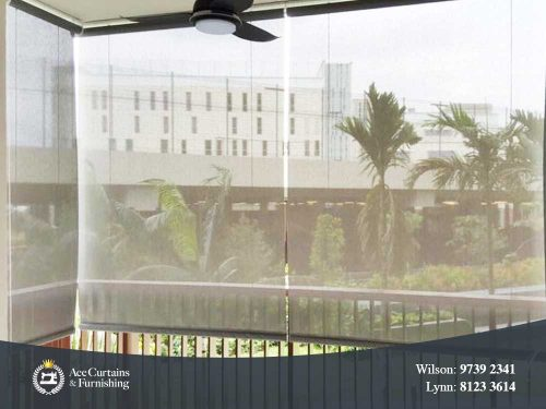 Translucent roller blind sun screen acting as day curtain in a balcony.