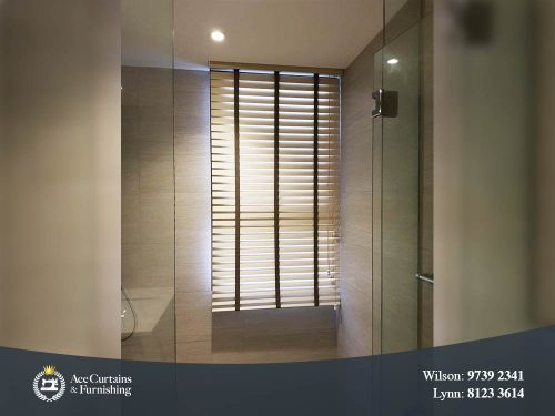 Venetian blind for bathroom providing privacy and light filtering.