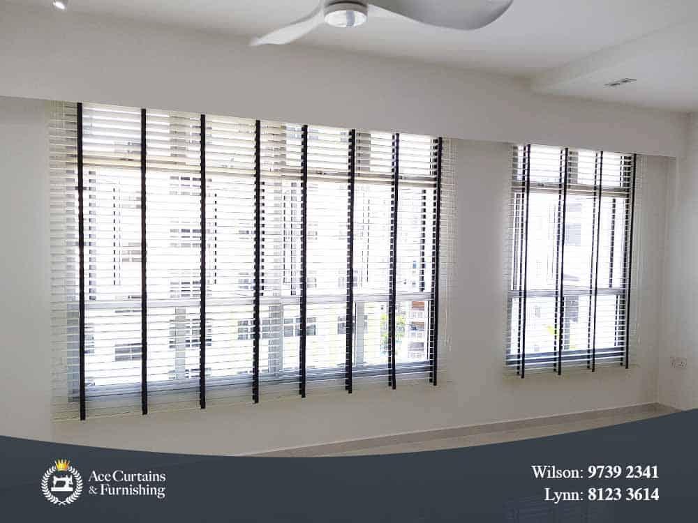 White venetian blinds in a living room tilted open.