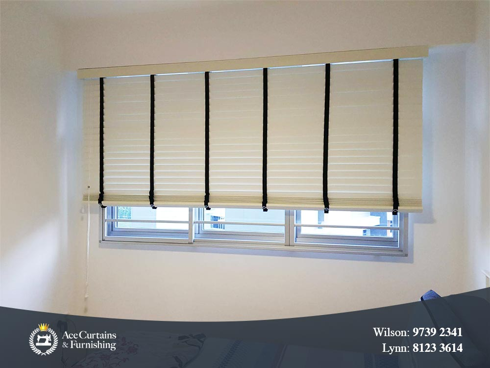 White venetian blind in a bedroom pulled up slightly.