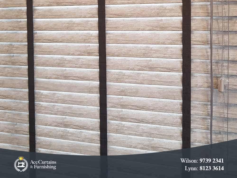Wooden venetian blind display with wood grain.