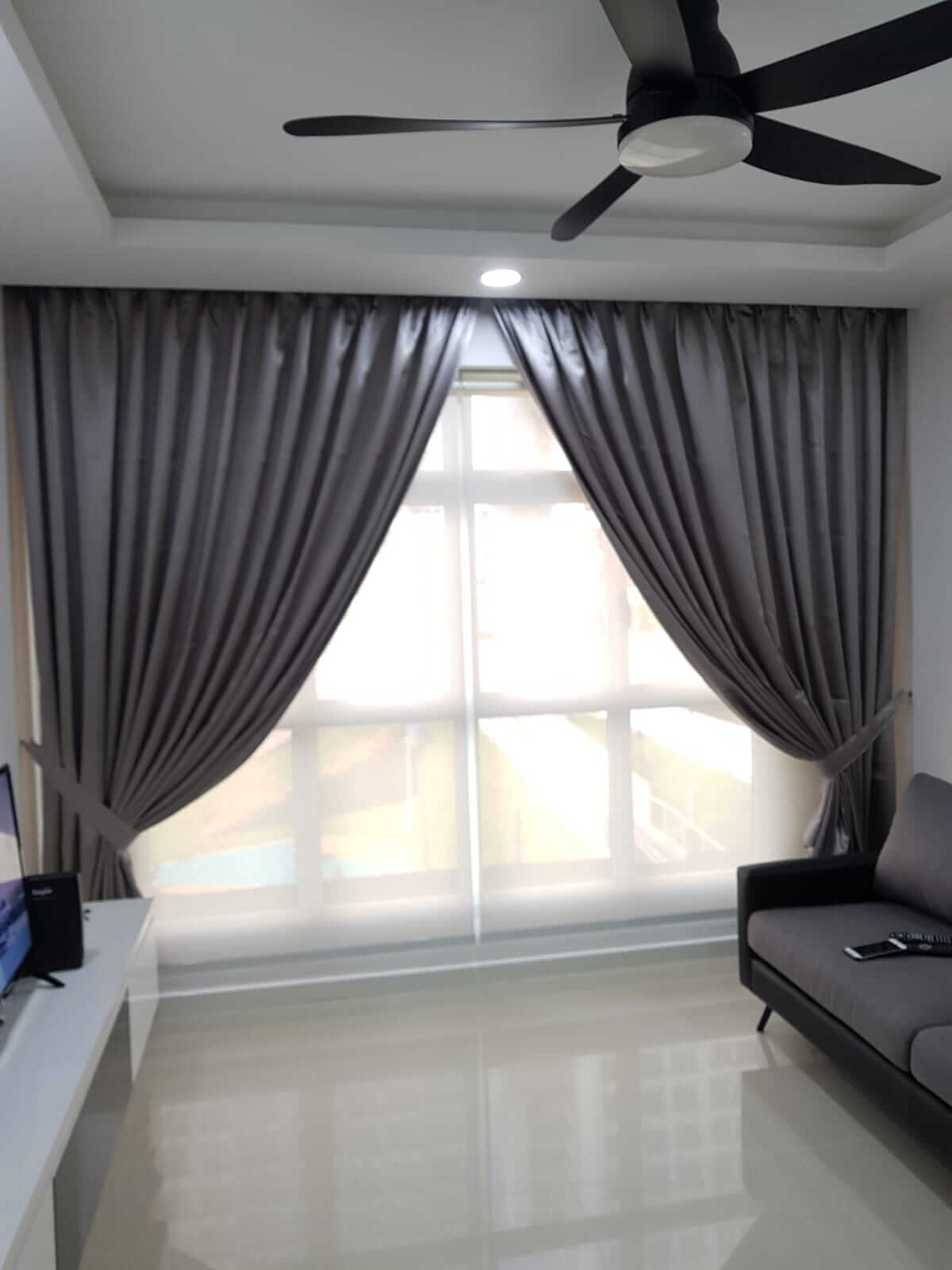 Day roller blinds with night curtains in living room